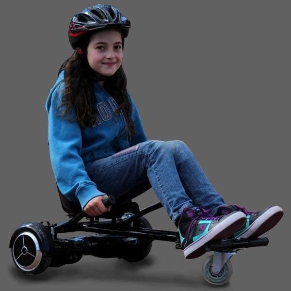 Riding a black GlideKart hoverboard seat attachment by Ride The Glide