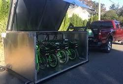 E bikes loaded into the new bike box, ready for you!