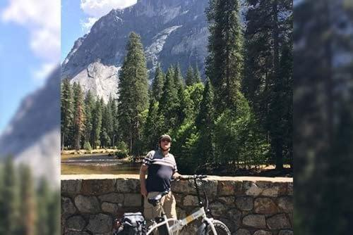 Happy customer travelling with his e-bike