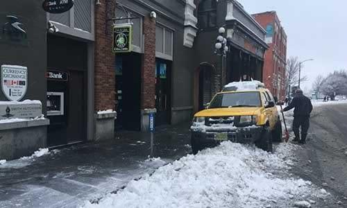 That is quite a pile of snow in front of the store!