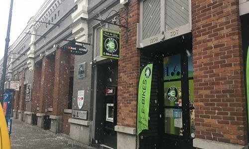Big snow flakes falling at our Wharf Street Storefront in downtown Victoria